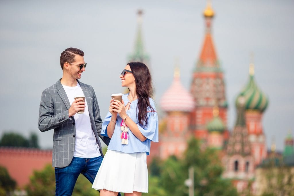 Young dating couple in love walking in city background St Basils Church